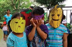Our Daycare children with vegetable-drawn masks
