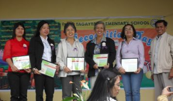 Some of our staff receiving a certificate of recognition from the Department of Education.