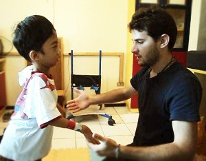 Daniele during his therapy session to a child