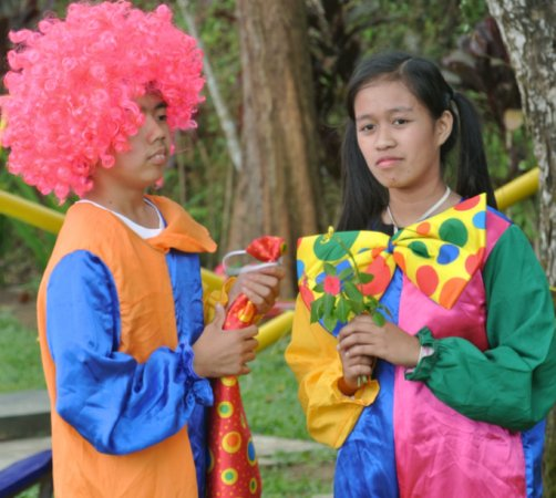 Teatro Pag-asa wearing clown costumes from Dr. Gary Minkowitz