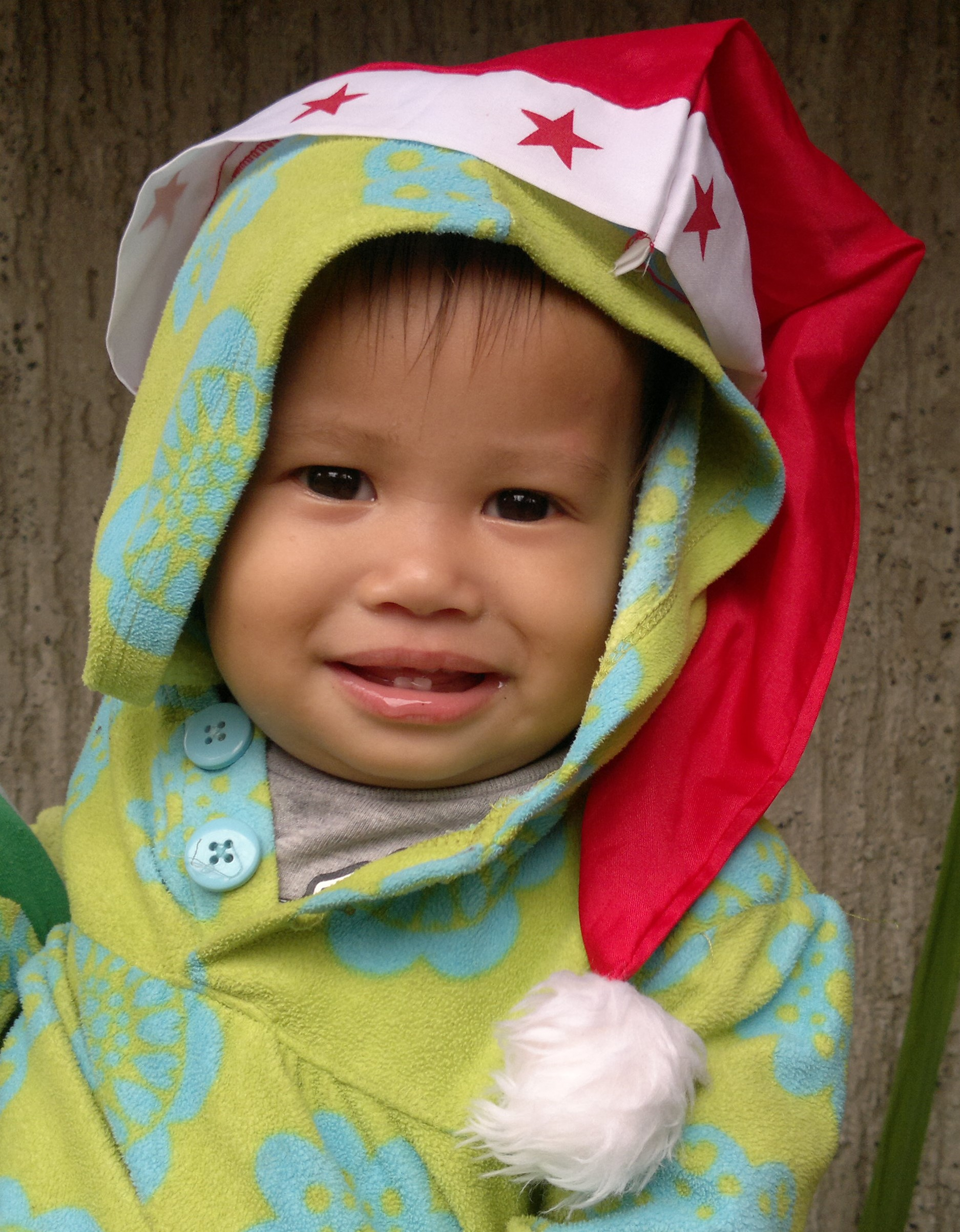 A Pag-asa Kid in Yuletide Outfit