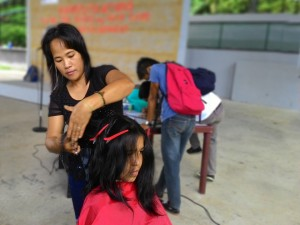 One of the Pag-asa mothers during the training on haircare.