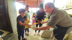 Dr. Christopher Trouw, with Dr. Philippe Caby, and Annemarie Messmann distributing pancake they prepared during the Dental/Medical Mission organized during the 20th anniversary week of Pag-asa.