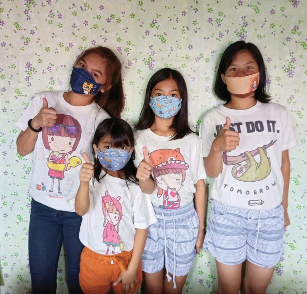 Our children sporting Linecense shirts and 3D facemasks.