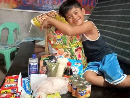 This boy beneficiary's smile upon receiving food and pandemic essentials is priceless