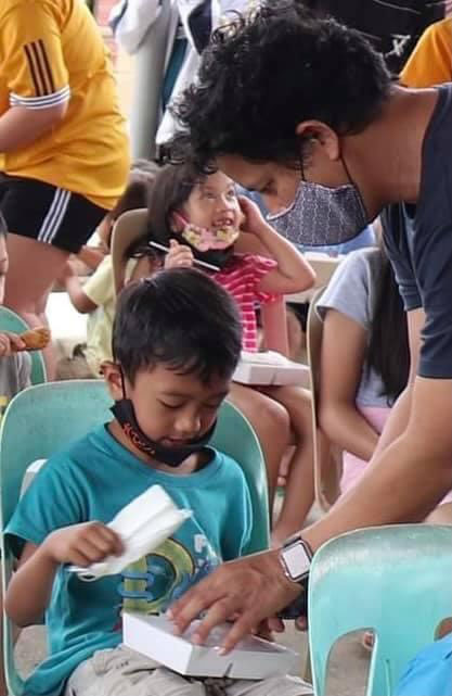 PSC Staff helping during the feeding program