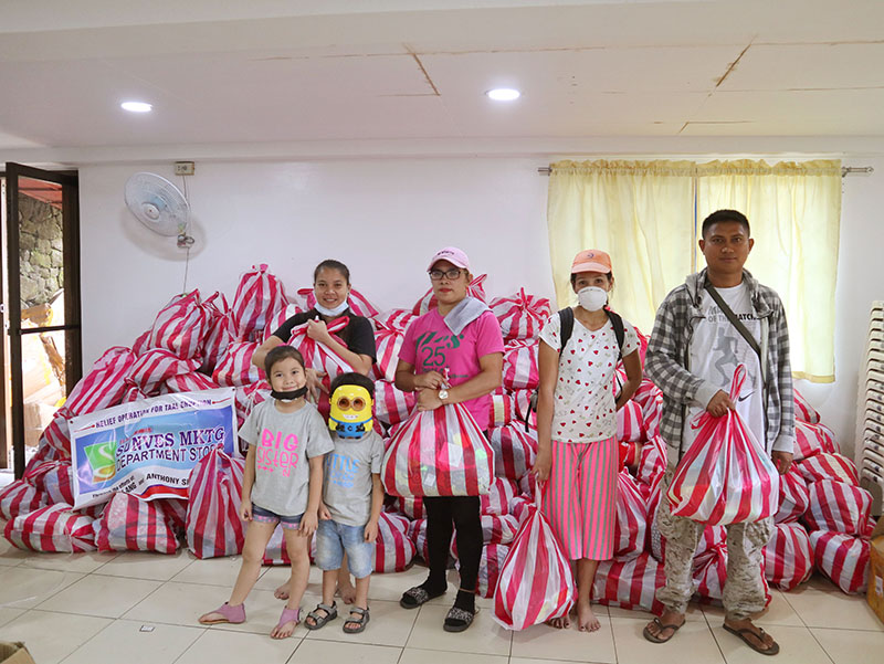 One of the families that received pandemic essentials inside the Pagasa building.