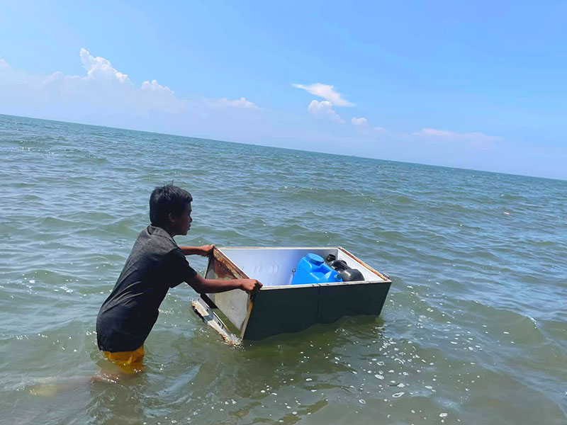 One of our beneficiaries in Noveleta with his makeshift vessel to fetch drinking water.