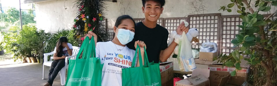 Our youth in Noveleta enjoy distributing The Noche Buena Project Christmas bags.